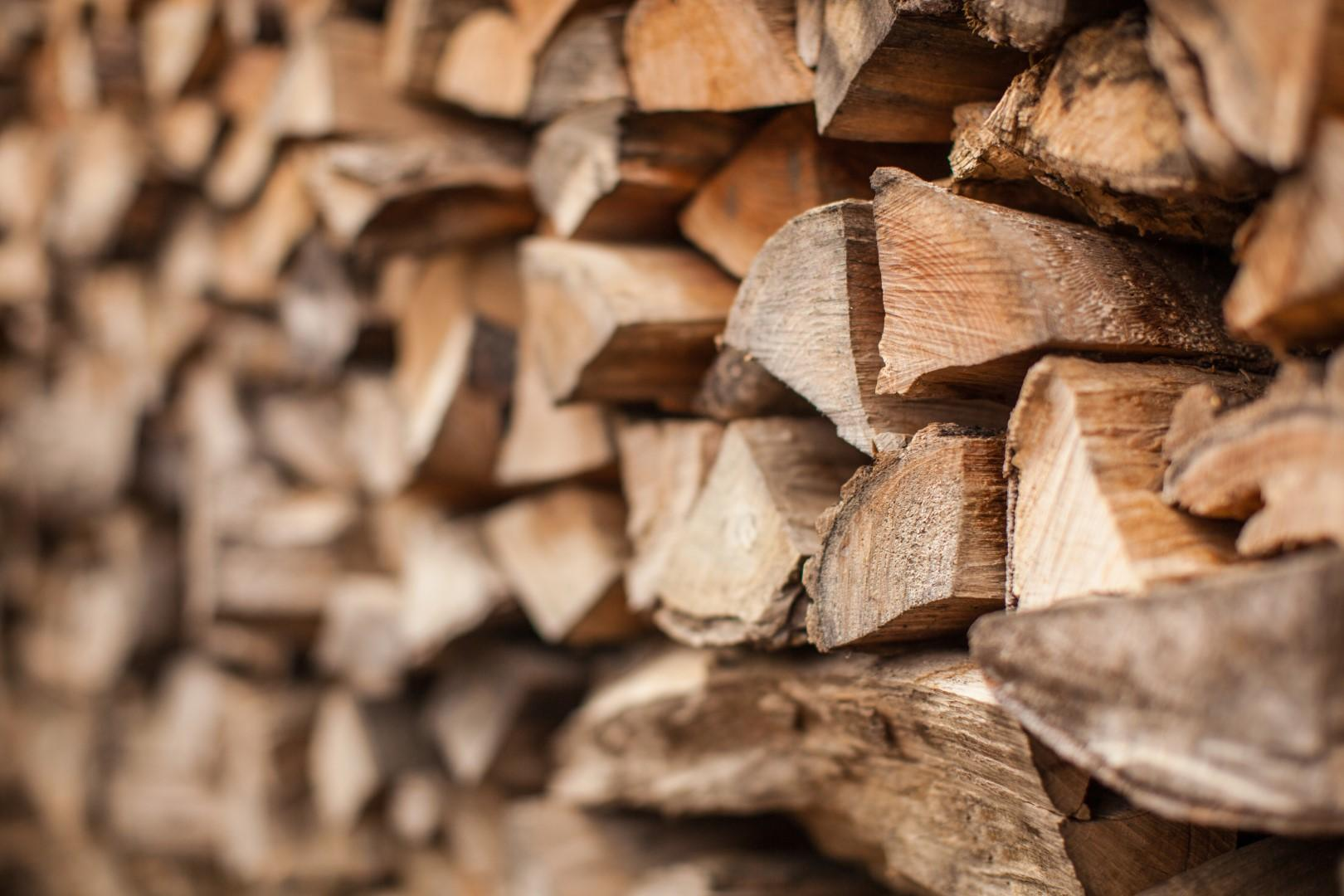 logs for sale in a stack